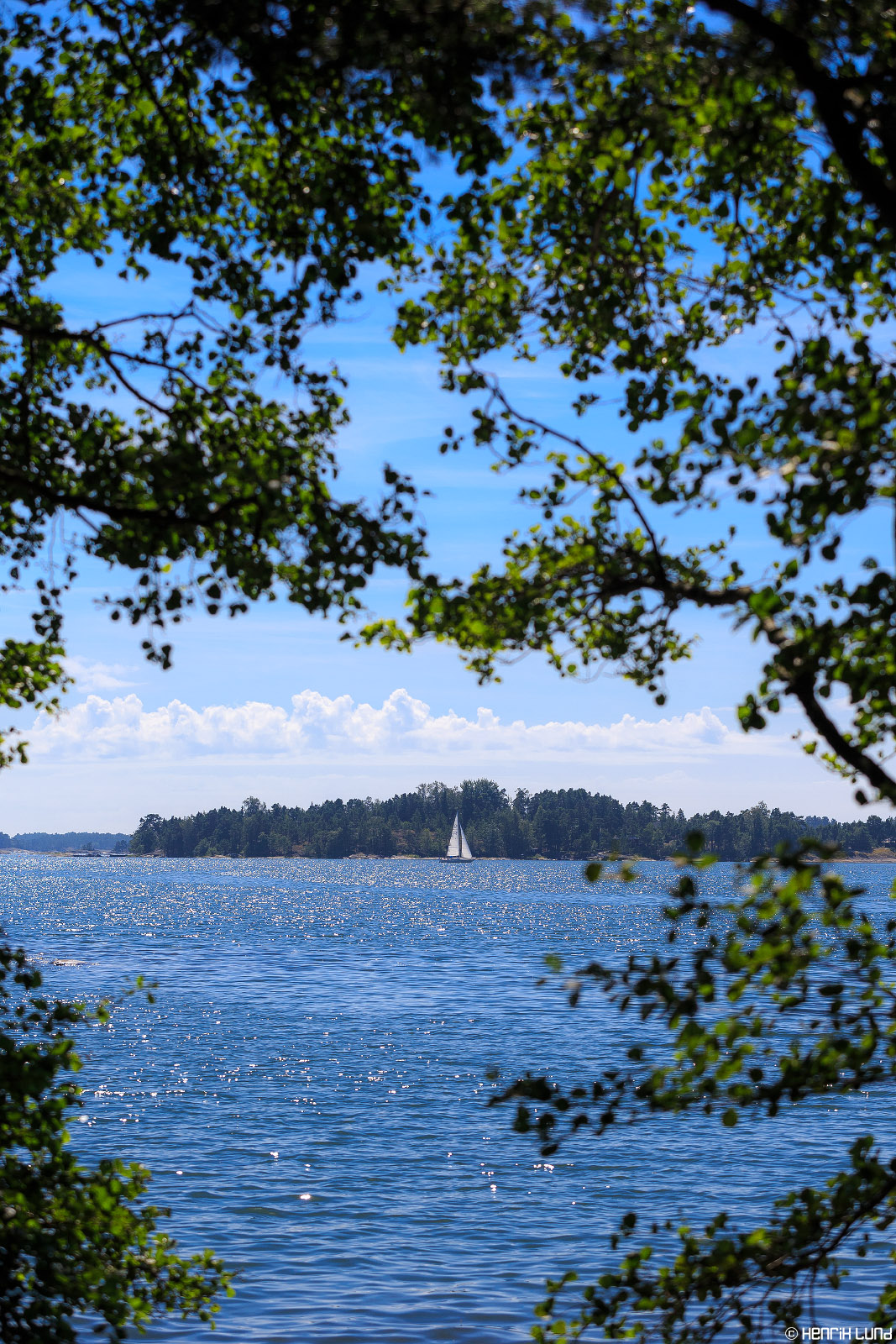 A maritime landscape - a sailing yacht passing by Stora Mistön -island in Raseborg archipelago, Finland, July 2014.
