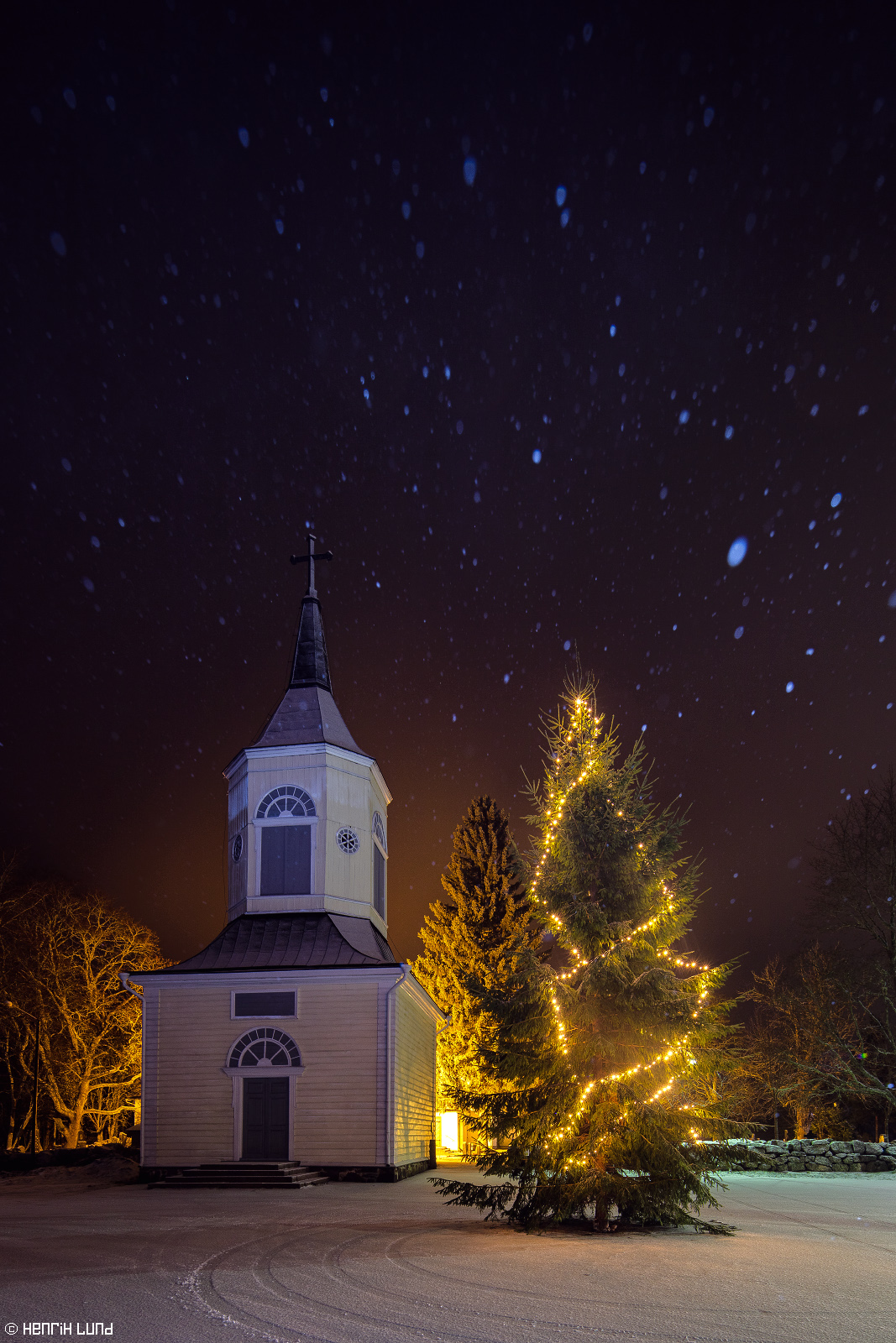 Merry Christmas - Happy Holidays. Some times the mood is just the right one - beautiful moments last for a very short time. Lappträsk church in snowfall. Finland. December 2015.