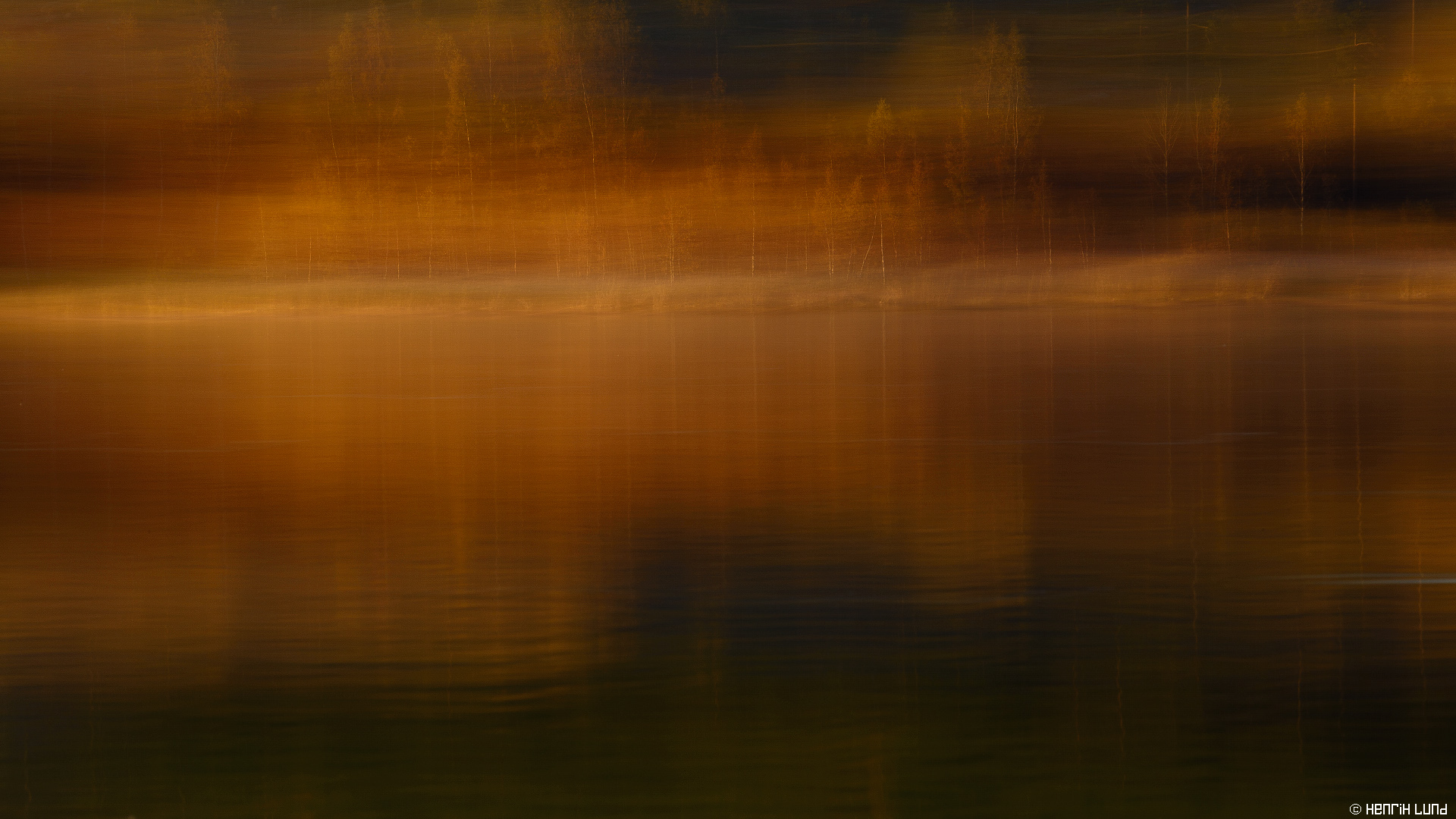 Panning autumn sunset colored trees. Lappträsk, Finland, October 2015.
