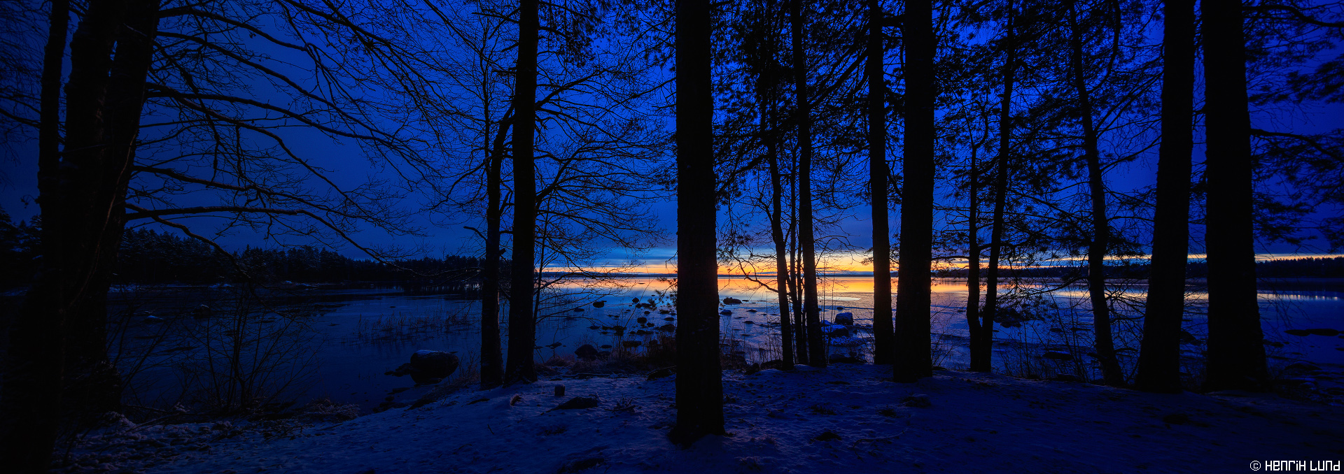 Panoramic view over the first snowy lakelandscape in Tommolansalmi, Mäntyharju. November 2015.