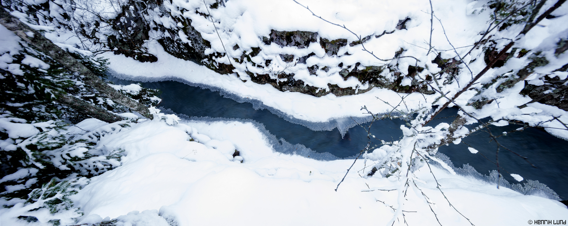 Detail panorama over a small rapids covered in snow and ice. Ålhusbäcken, Liljendal, Lovisa, Finland. January 2016.