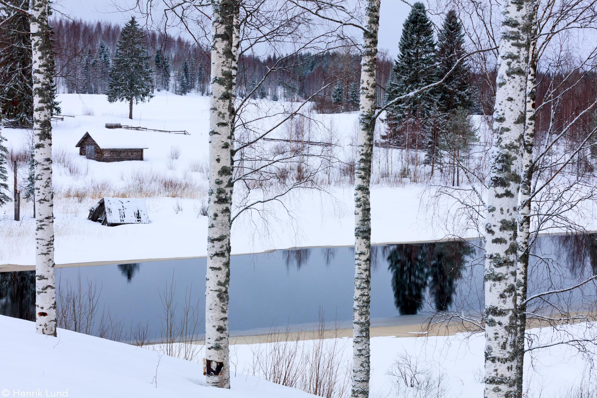 View over Onnenvirta in Hoilola, Tuupovaara, Joensuu, Finland. February 2017.