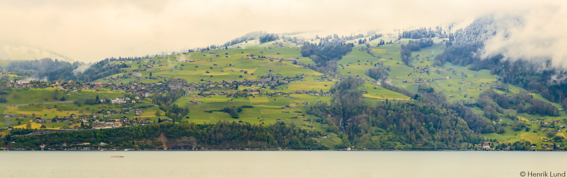 Panoramic view from Spiez over lake Thun. Switzerland, April 2017.