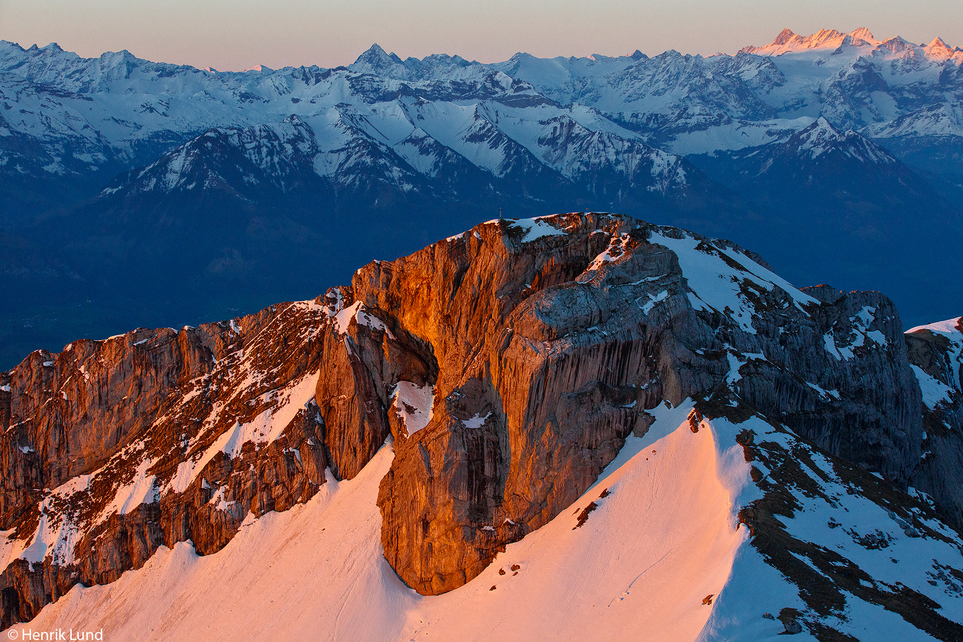 Sunset at the alps - view over Matthorn in the front and Jungfrau at the right. Mount Pilatus, Lucerne, Switzerland, Europe. April 2018.