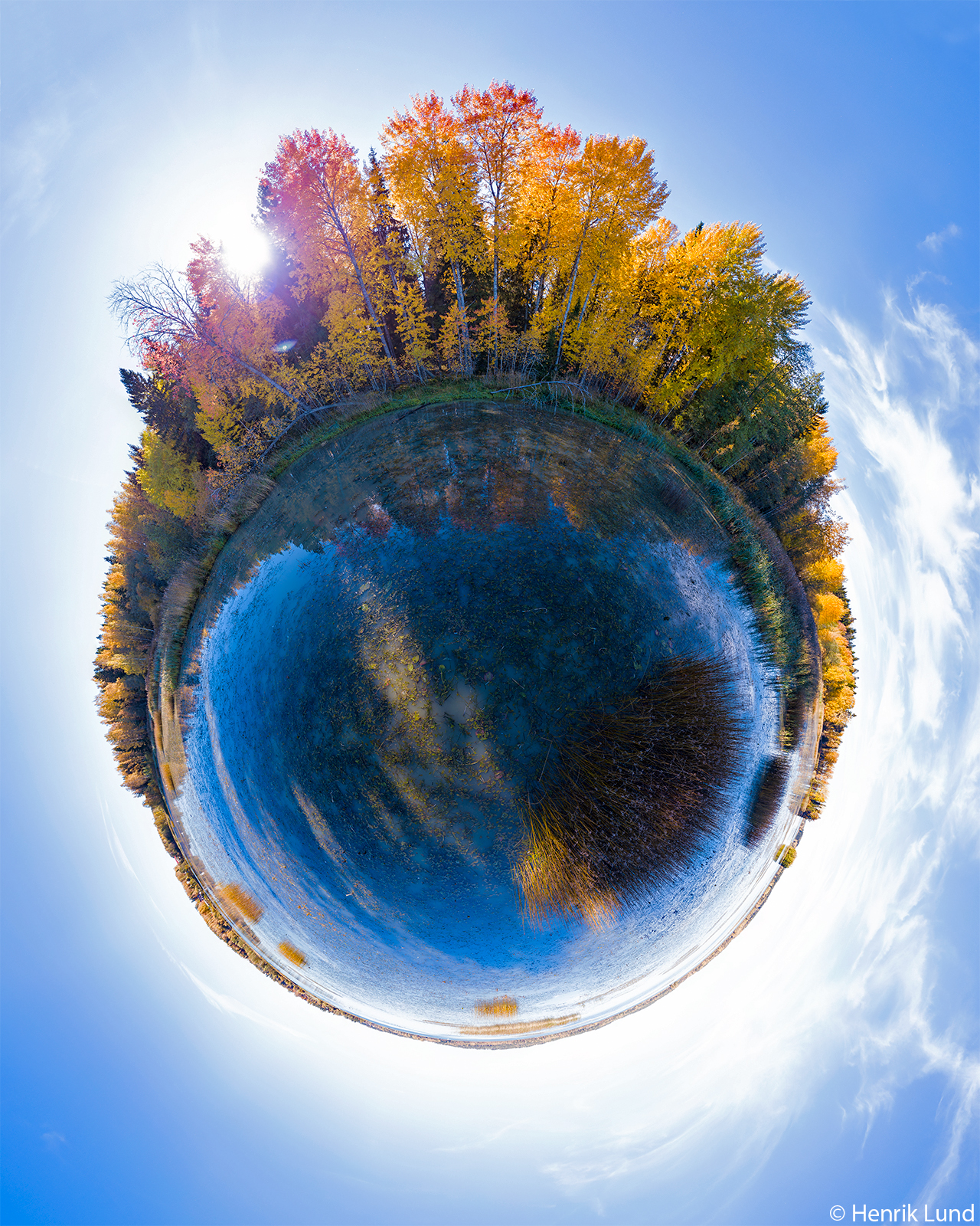 360 degrees little planet aerial view over colorful aspens. Lappträsk, Finland. October 2018.
